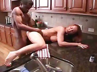 Wife fucking her BBC in the kitchen