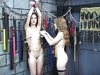 Lesbian bdsm dominatrix teases the nipples on this tiny tit young teen