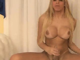 Busty shemale Lara Gaucha tugging on her stiff dick