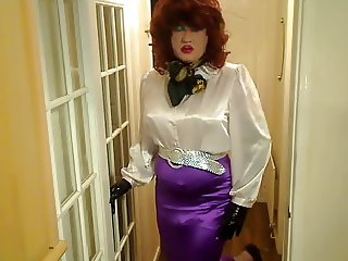 Candi in satin blouse and skirt