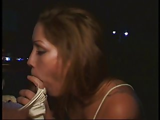 Sultry brun slut with tattoo sucks hard black luscious meat outside a night bar
