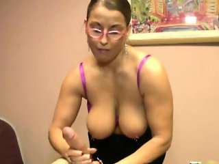 Mature cougar with spex jerks hard dong