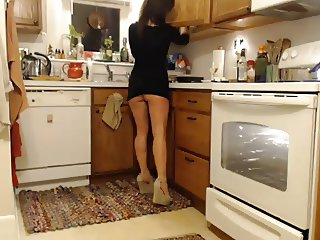 Spying on hot MILF in kitchen wearing no pants!