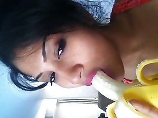Desi Girl showing how to suck cock with a banana