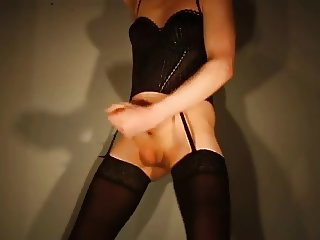 crossdresser in stockings & corsage cumming