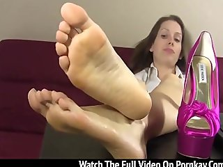 Naughty babe teasing with her perfect feet