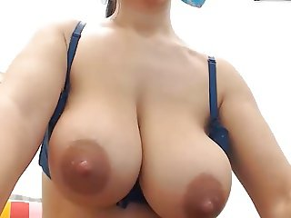 Big natural tits with large nipples flashed