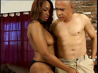 Sexy curvy c-cup black babe in thigh-highs kneels to give dude expert handjob