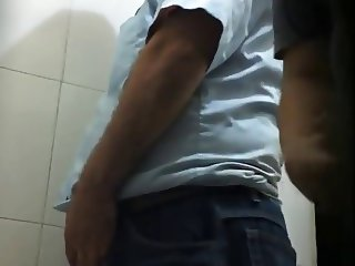 two men jerking in toilet