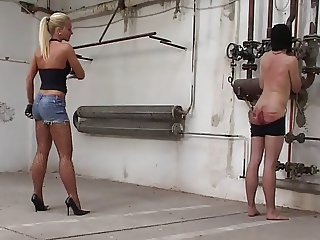 Long whipping and caning by two mistresses