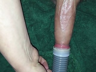 Cock sucking with a  vacuum cleaner with cum shot