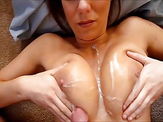 Boyfriend jacks off a major load on a pair of huge tits