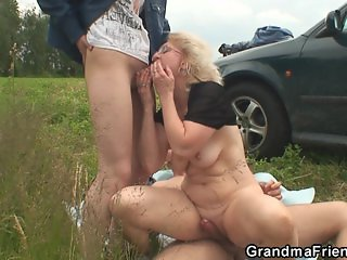 Blonde granny double penetration in the field
