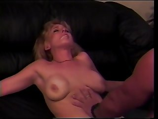Busty blonde gets her lips around a hard cock