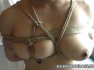 Asian amateur beauty tied up and palced on the bed