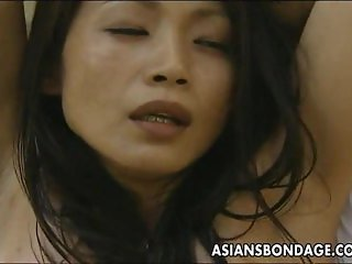 Asian bitch roped up so the man can fuck her