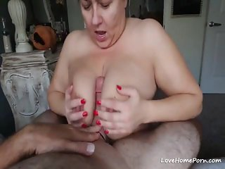 Busty mature wife sucks a big fat cock
