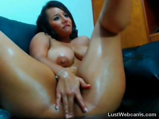 Busty latina fingers her pussy on webcam