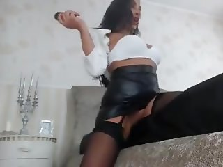 Raven Haired Milf Shows Off In Sexy Leather Skirt