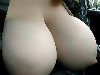 breasts swollen with milk splashing