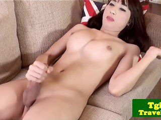 Bigtitted asian ladyboy jerking cock