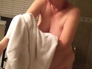 Wife drying off her fat tits after shower.