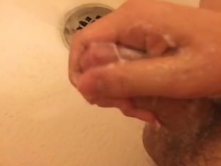 Stroking soapy cock till cum