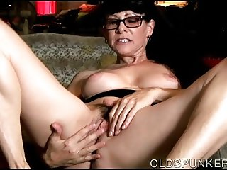 Sexy old spunker thinks of you as she fucks her juicy pussy
