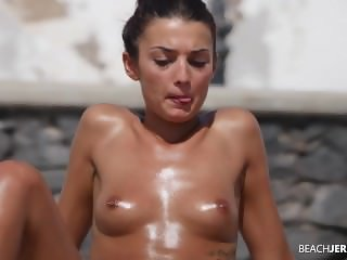 Hot Tanned Topless Babe with Pierced Nipple Filmed on Beach by Voyeur