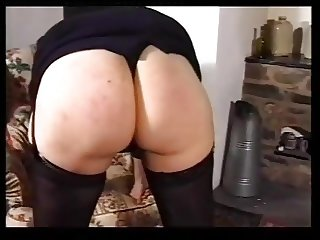 MILF spanked and caned.