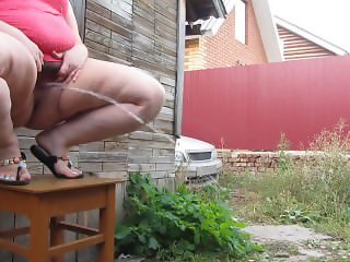 plump, hairy by a pussy, pissing stream