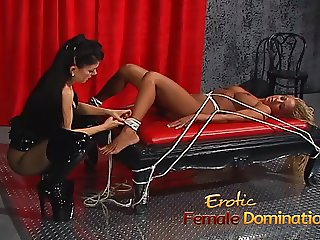 Mesmerizing blonde slave girl dominated by the merciless