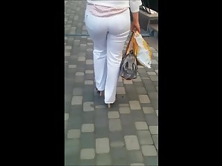Milf on street in white jeans with big butt