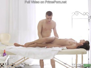 Teen having passionate sex on the massage tab