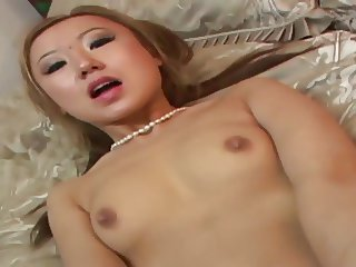 Asian doll gets both holes filled whith a huge dong