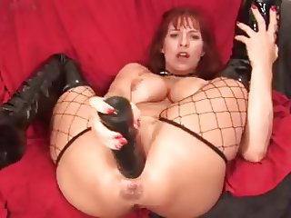 Redhead Milf destroys her pussy with huge dildo