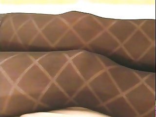 Black opaque diamond stockings with foot play