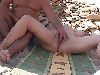Masturbate on the beach.