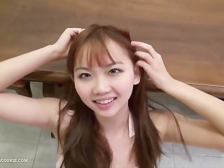 Asian cutie fucking in pink playsuit