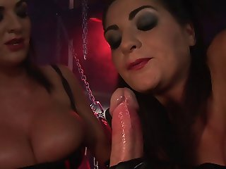 Kinky curvy brunette duo suck hard on a cock
