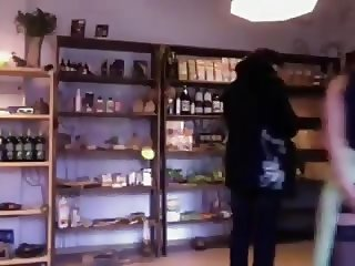 Seller flashing ass and apple insertion in shop