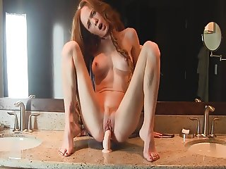 Redhead Girl Rides Dildo Mounted In Bathroom