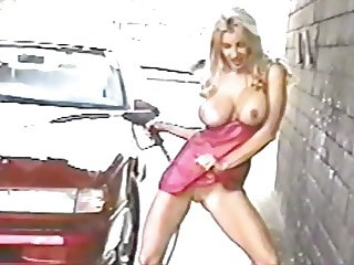Big tit blonde flashes while washing car