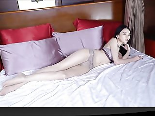 Cute girl in pantyhose on bed (YST)