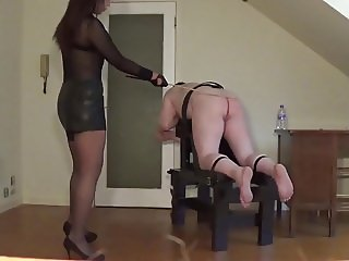 Miss Sultrybelle canes a willing sub.