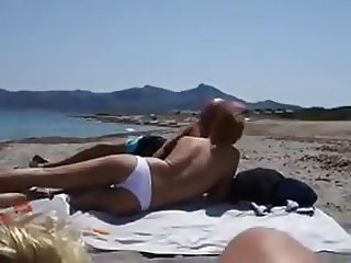 Cum in mouth at swinger beach
