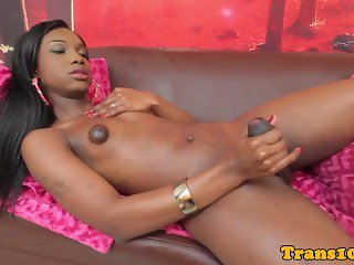Nubian tranny strokes her cock and climaxes