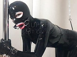 Bupshi - latex slut on ass hook