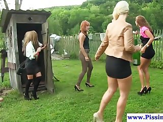 Outdoor pissing babes share cock in pee group