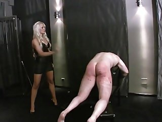3 ladies caning crying man